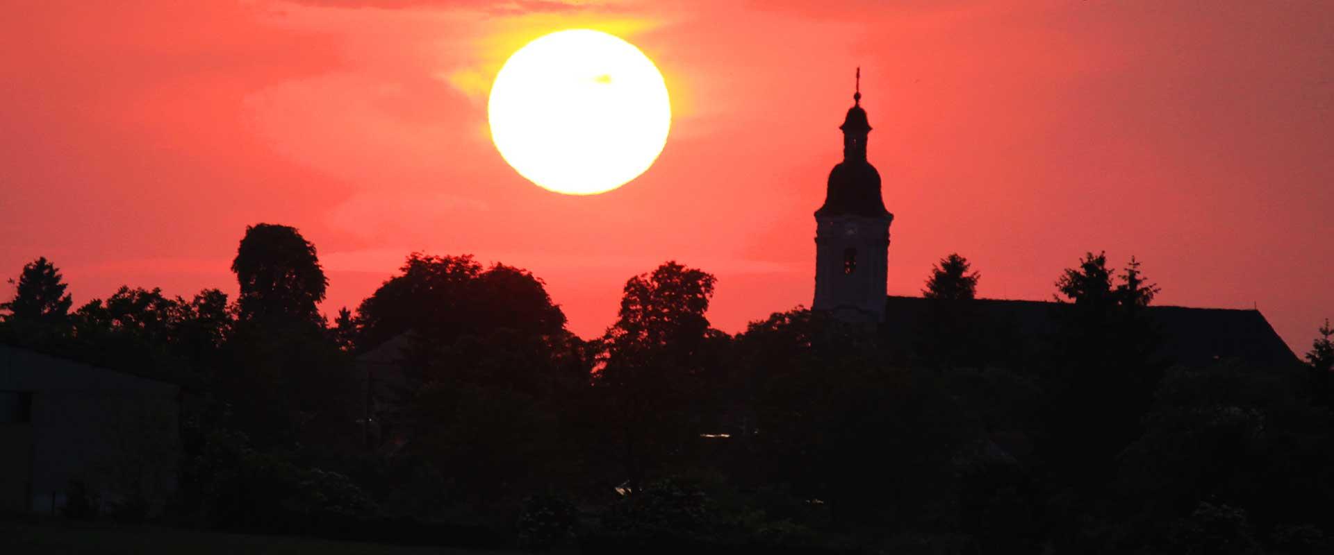 21x9_zapad-slnka-kostol
